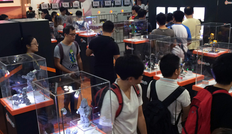 Photo of people milling around some collectible toy figures