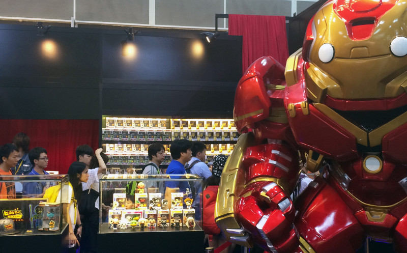 Photo of people lining up next to Iron Man